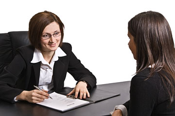 a human resources staffer interviewing a prospective employee